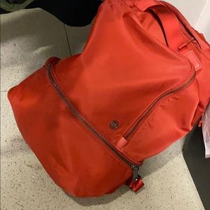Lululemon red backpack has a laptop sleeve
